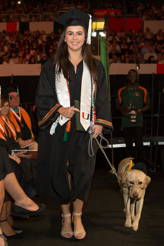 Graduate walking with UPup service dog