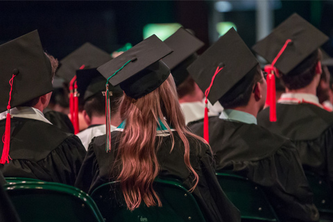 Grads with Orange and Green Tassels