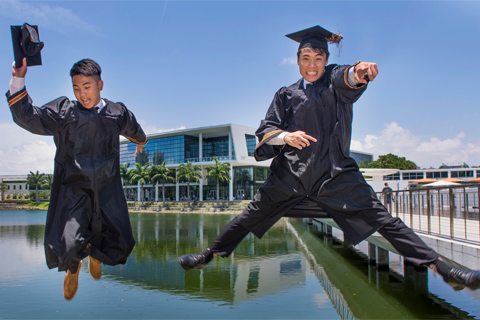 Grads Jumping in front of Lake Osceola