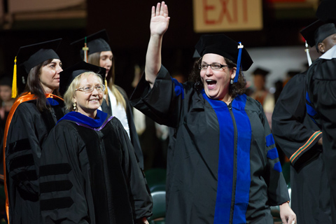 Faculty Waiving during Procession